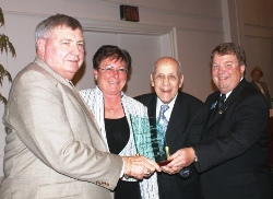 John A. Logan College trustee Jake Rendleman (left) receives ICCTA's 2010 Ray Hartstein Trustee Achievement Award from ICCTA president Barbara Oilschlager, ICCTA Honorary Member Ray Hartstein (left) and ICCTA vice president David Harby.