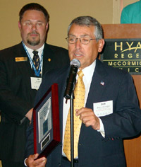 Robert Ontiveros of Group O accepts ICCTA's 2005 Business/Industry Partnership Award.