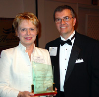 Dr. Alice Jacobs accepts ICCTA's inaugural Advocacy Award from ICCTA president Tom Bennett.