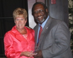 Dr. Gayle Saunders accepts ICCTA's 2012 Advocacy Award from ICCTA vice president Reggie Coleman.
