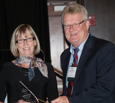 Deborah Nelson accepts ICCTA's 2012 Distinguished Alumnus Award from former ICCTA president Rich Anderson.