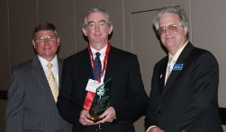 Dr. Dennis G. Hall (center) accepts ICCTA's 2009 Distinguished Alumnus Award from Illinois Community College Board chair Guy Alongi (left) and ICCTA president Jeff May.