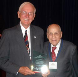 Kaskaskia College trustee Jim Beasley (left) receives ICCTA's 2008 Ray Hartstein Trustee Achievement Award from ICCTA Honorary Member Ray Hartstein.
