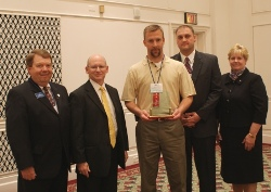 ICCTA vice president David Harby (left) congratulates Richland Community College officials Doug Brauer (second from left) and Kathy Carter (far right) and IBEW representatives Jason Drake (center) and Shad Etchason on earning ICCTA's 2010 Business/Industry Partnership Award.