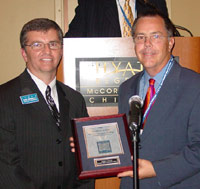 Jack Daley (right) receives his ICCTA Certificate of Merit from vice president Tom Bennett.