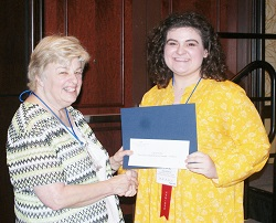 Southeastern Illinois College student Callie Smith (right) accepts her $500 Paul Simon Student Essay Contest scholarshipfrom ICCTA secretary Kathy Spears.