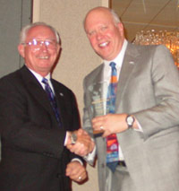 Dr. Gary W. Davis (right) accepts ICCTA's inaugural Ethical Leadership Award from longtime Elgin Community College trustee John Duffy