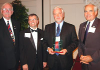 Bruce L. Conners (third from left) accepts ICCTA's 2006 Gary W. Davis Ethical Leadership Award from Kaskaskia College trustee Jim Beasley, ICCTA president Tom Bennett, and KC president James Underwood.