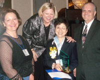 Jane Wu of the College of DuPage (center) accepts ICCTA's 2007 Outstanding Faculty Member Award from COD trustee Mary Mack, ICCTA president (and COD trustee) Kathy Wessel, and COD board chair Micheal McKinnon.