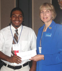 Brandon Smith accepts ICCTA's 2007 Gigi Campbell Student Trustee Excellence Award scholarship from ICCTA president Clare Ollayos.
