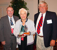 Margot McAfoos accepts ICCTA's 2006 Lifelong Learning Award from Rend Lake College trustee Marvin Scott (left) and president Mark Kern.