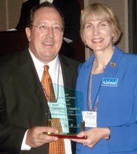 Geoffrey Obrzut accepts ICCTA's 2007 Meritorious Service Award from ICCTA president Clare Ollayos.