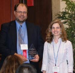 David Shenaut and Leticia Concalves of Monsanto Company accept ICCTA's 2012 Business/Industry Partnership Award.