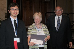 Elgin Community College student Mauro Rosiles (left) accepts his $500 Gandhi/King Peace Essay Scholarshipfrom ICCTA secretary Kathy Spears and Oakton Community College trustee emeritus Jody Wadhwa.