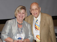 Kathy Wessel receives ICCTA's 2011 Ray Hartstein Trustee Achievement Award from award namesake Ray Hartstein.