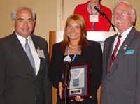Jill Tomaszewski accepts ICCTA's 2005 Pacesetter Award with Kaskaskia College president Dr. James Underwood and KC chair Jim Beasley.